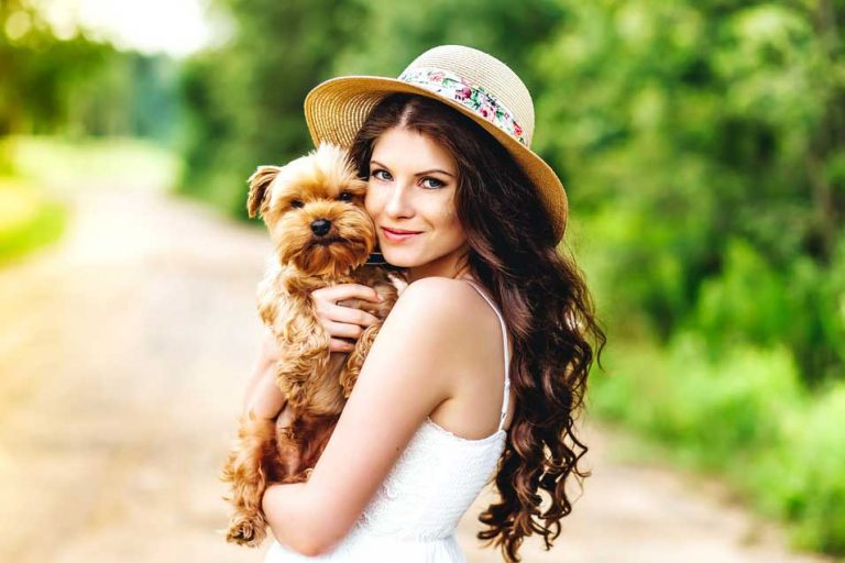 Picture of woman holding a small dog