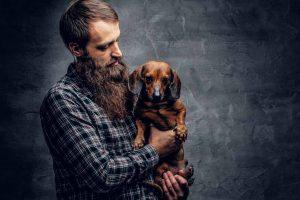 man holding a sick dog