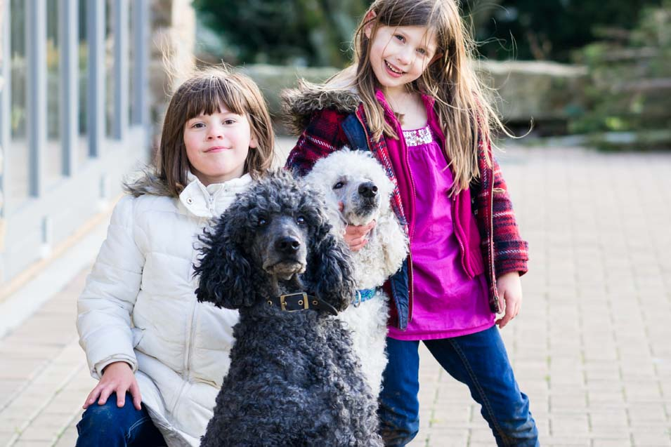 Picture of two girls with poodles