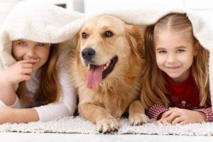 Picture of two girls with a Golden Retriever