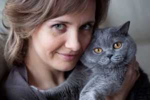 Picture of a woman holding a grey cat