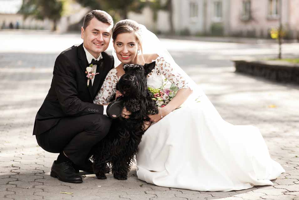 Picture of bride and groom with their dog