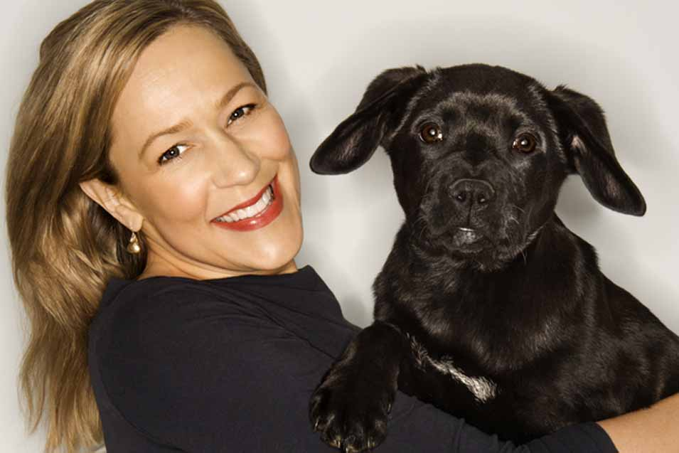 Picture of black dog and a woman