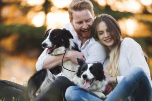 Picture of couple holding dogs