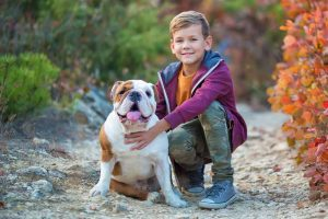 Picture of a boy and a bulldog