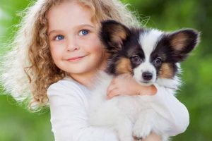Picture of a girl holding a dog