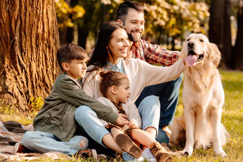 Picture of a family with a Golden Retriever