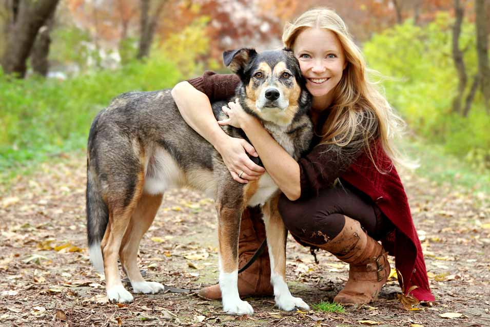 Picture of a woman and her dog outside