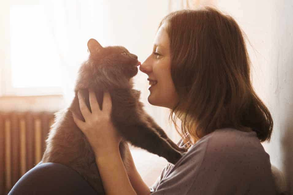 Picture of a woman holding her cat
