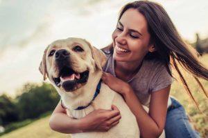 Picture of a Labrador Retriever and a woman