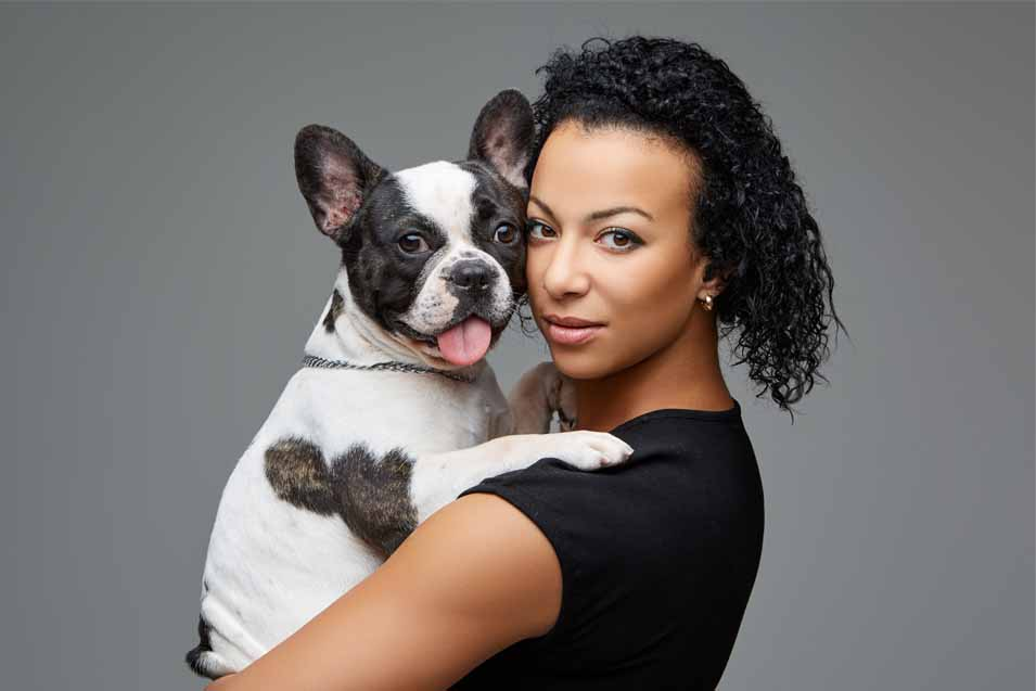 Picture of a woman holding her dog
