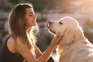 Picture of a woman petting her dog