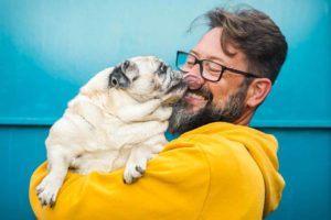 Picture of man holding a pug