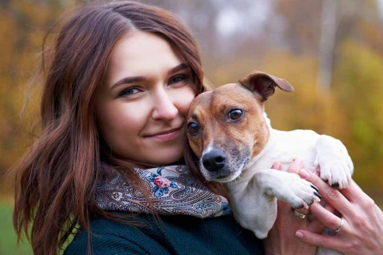 Picture of a woman holding a dog